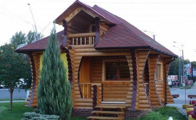 Дом из оцилиндрованного бревна или профилированного бруса: что выбрать