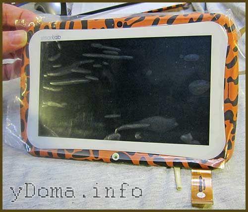 Фото приклеенного сенсорного стекла на рамку планшета