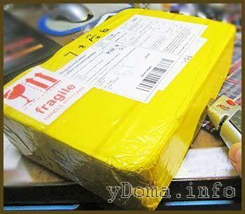 Фото вскрытия почтовой посылки с сенсорным стеклом