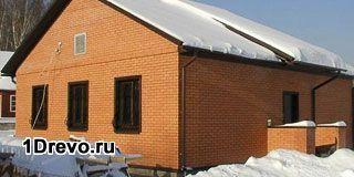 Наружная отделка деревянного дома кирпичом