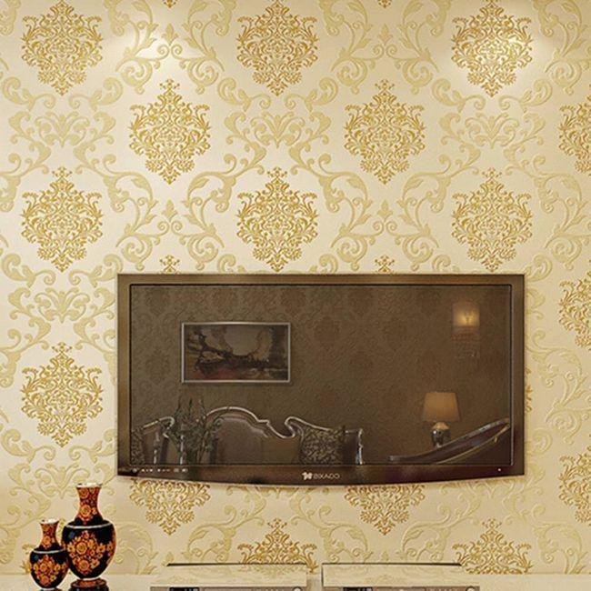 Золотистые обои отлично дополнят современный и стильный интерьер гостиной